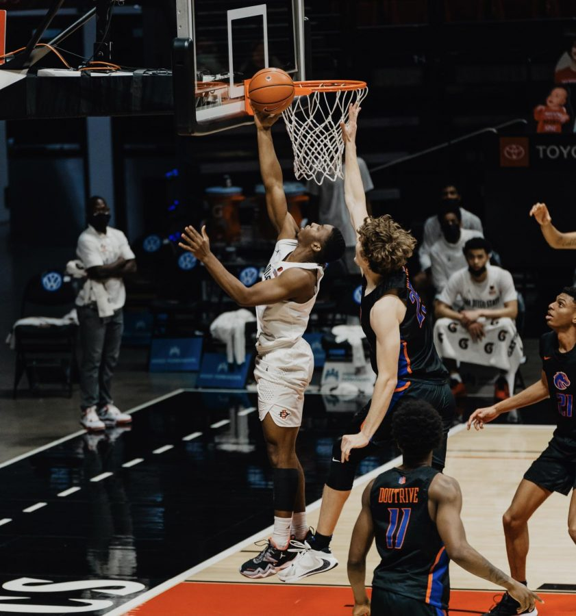 San Diego State men's basketball freshman guard Lamont Butler attempts a layup during the Aztecs' 78-66 overtime win over Boise State on Feb. 25, 2021 at Viejas Arena.
