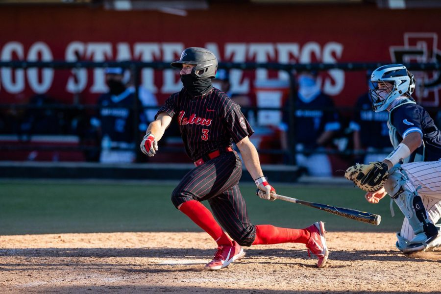 San Diego State baseball redshirt sophomore catcher Wyatt Hendrie finishes his follow-through on a swing during the Aztecs' series against San Diego on Feb. 19-21, 2021.