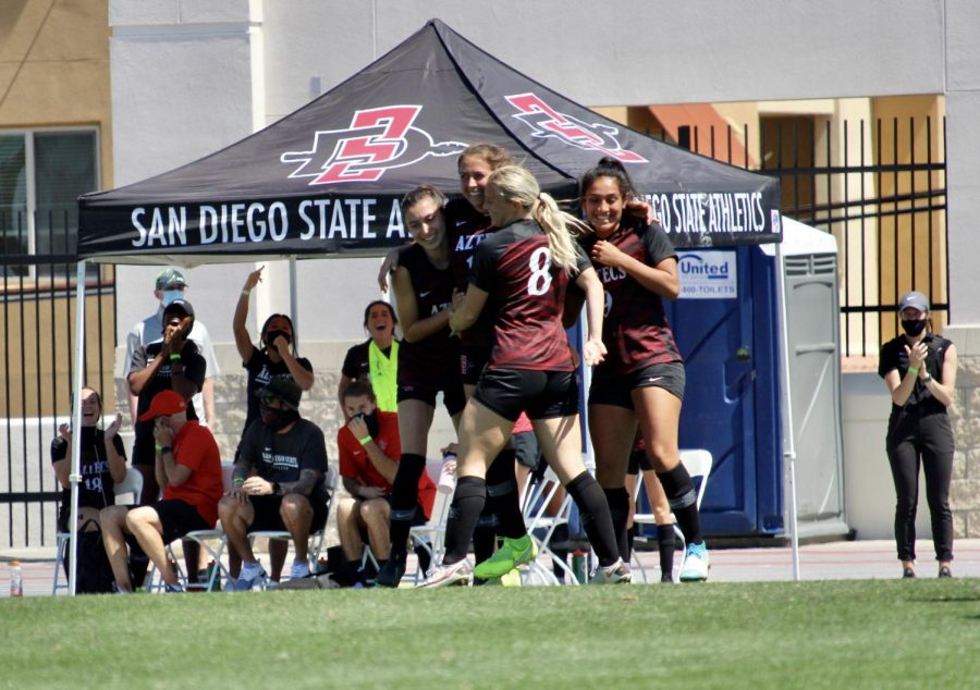 Members of the San Diego State women's soccer team celebrate after a goal during the Aztecs' 3-0 win over San José State on March 29, 2021 at the SDSU Sports Deck.