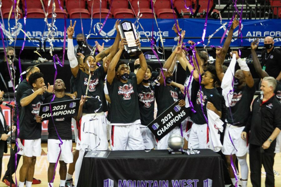 The San Diego State men's basketball team celebrates with the Mountain West Conference tournament trophy after defeating Utah State 68-57 to become MWC tournament champions on March 13, 2021 at the Thomas & Mack Center in Las Vegas.