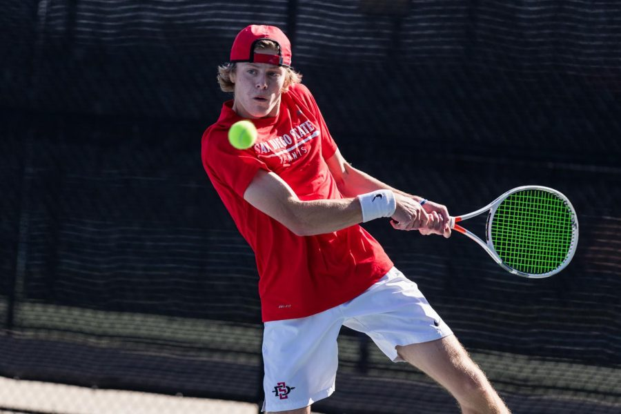 San Diego State men's tennis freshman Judson Blair swings his racket at a ball during a competition during the 2020-21 season.