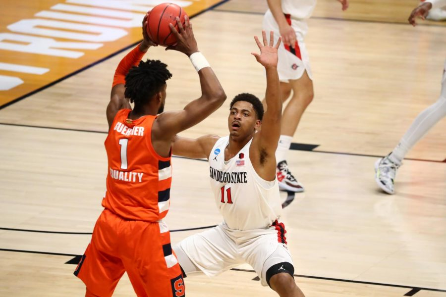 San Diego State men's basketball senior forward Matt Mitchell guards Syracuse sophomore forward Quincy Guerrier during the Aztecs' 78-62 loss to the Orange during the first round of the NCAA Tournament on March 19, 2021 at Hinkle Fieldhouse in Indianapolis.