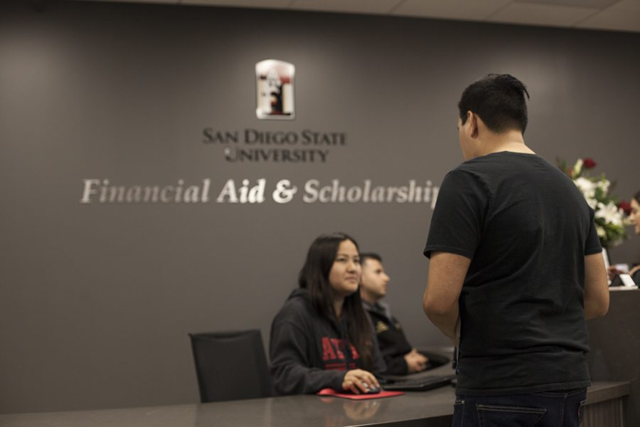 A student talks to a representative at the San Diego State office of Financial Aid and scholarships