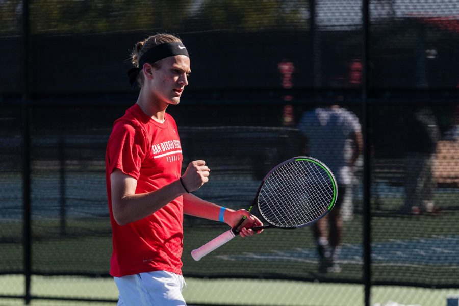 San Diego State men's tennis freshman Roni Rikkonen pumps his fist during the 2020-21 season.
