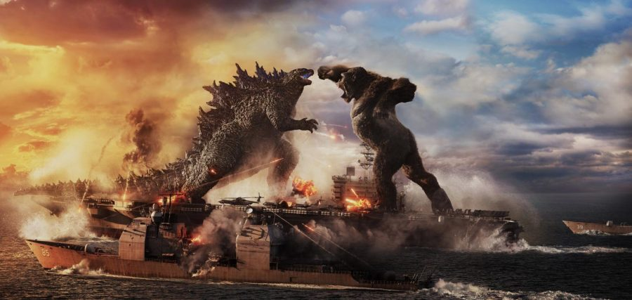 """(L-r) GODZILLA battles KONG in Warner Bros. Pictures' and Legendary Pictures' action adventure """"GODZILLA VS. KONG,"""" a Warner Bros. Pictures and Legendary Pictures release. (© 2021, Warner Bros. Pictures and Legendary Pictures)"""