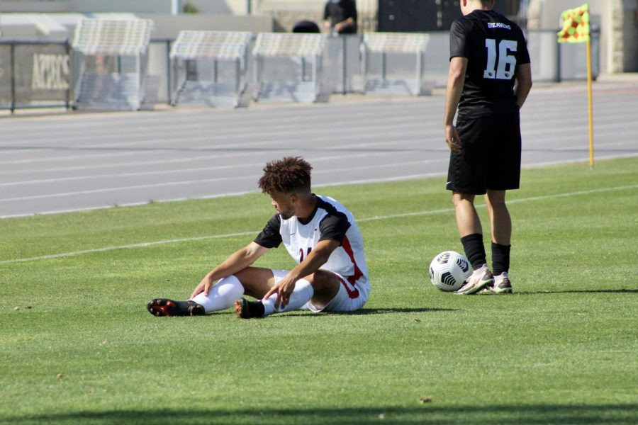 San Diego State men's soccer freshman midfielder Bryson Hankins sits down after a foul during the Aztecs' 4-0 loss to Oregon State on April 17, 2021 at the SDSU Sports Deck.