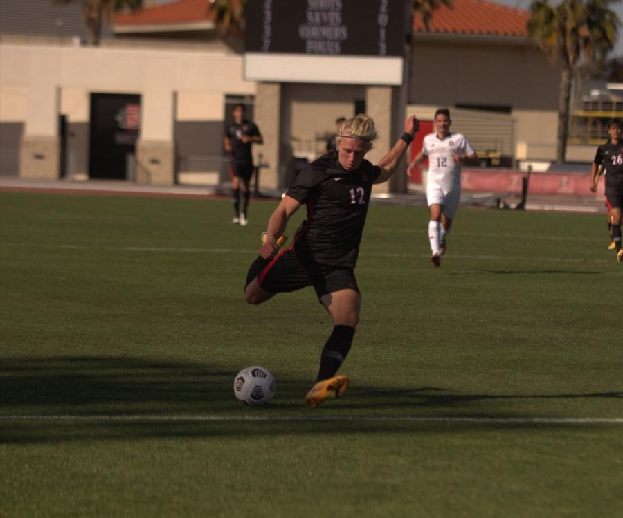 San Diego State men's soccer sophomore forward Austin Wehner scores inside the box to give San Diego State a 2-0 lead in the 36th minute. The Aztecs defeated then-No. 4 Washington 2-0 on March 28, 2021 at the SDSU Sports Deck.