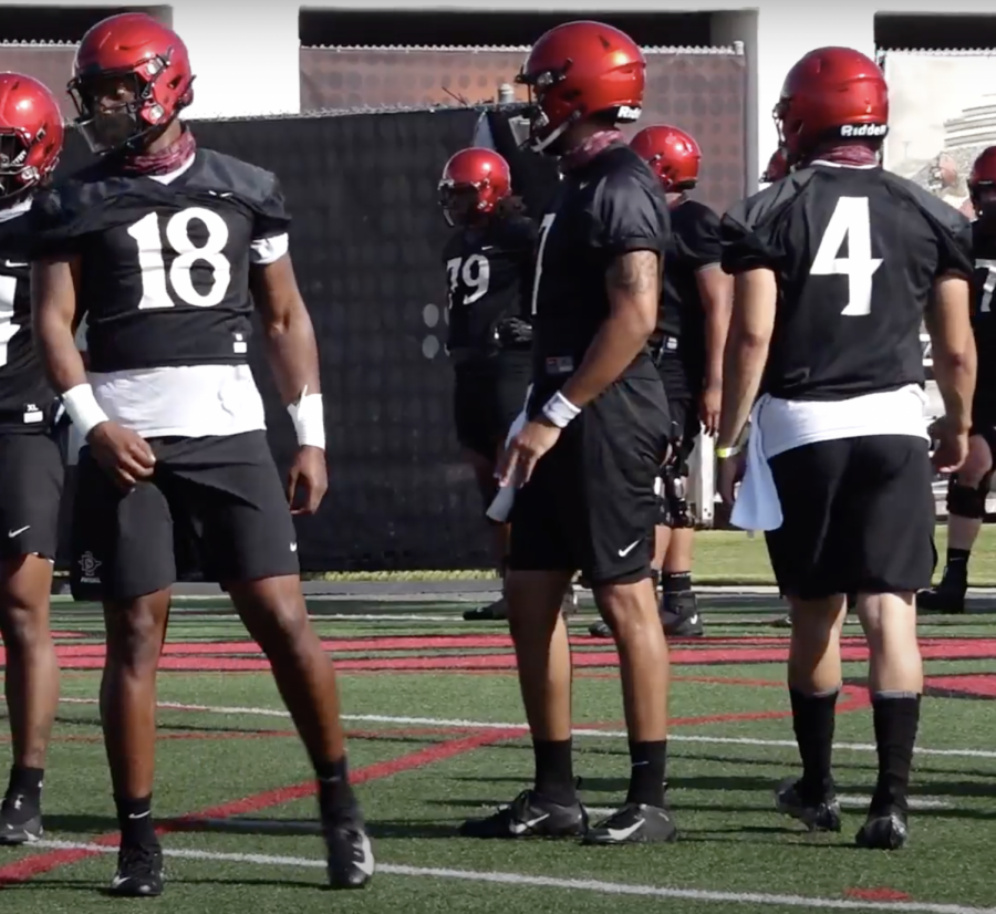 San Diego State football sophomore quarterback Jalen Mayden stands next to senior quarterbacks Lucas Johnson and Jordon Brookshire during a spring practice in early April 2021.