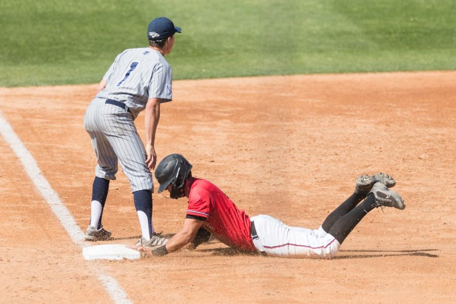 San Diego State redshirt sophomore outfielder Jaden Fein slides into third base during the Aztecs' doubleheader against Nevada on April 10, 2021 at Tony Gwynn Stadium.