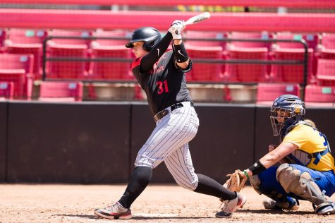 San Diego State softball freshman catcher Sadie Langlet swings at a pitch during the Aztecs