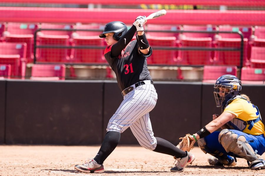 San Diego State softball freshman catcher Sadie Langlet swings at a pitch during the Aztecs' 14-3 win over San José State on April 18, 2021 at the SDSU Softball Stadium.