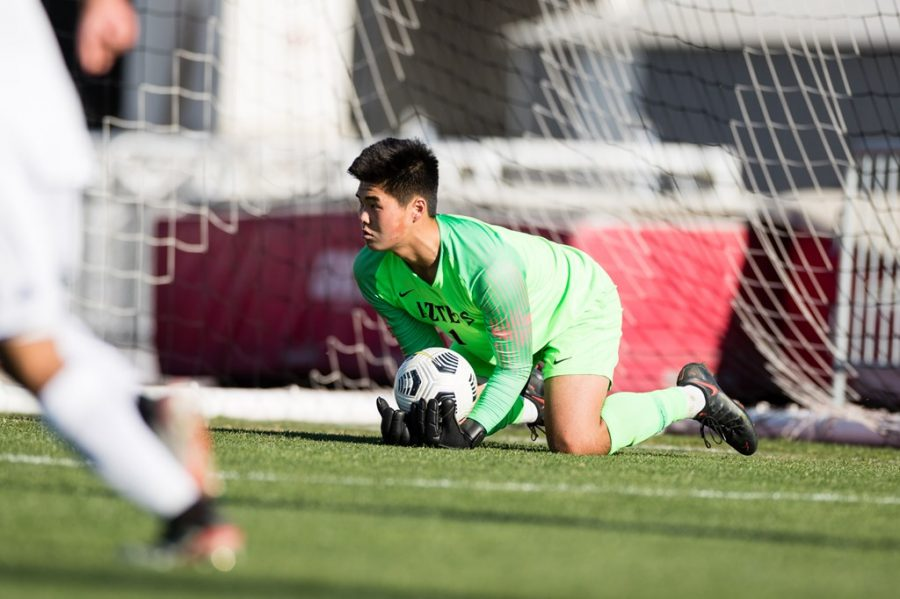 San Diego State men's soccer sophomore goalkeeper Tetsuya Kadono makes a save during the Aztecs' 2-0 upset over No. 4 Washington on March 28, 2021 at the SDSU Sports Deck.