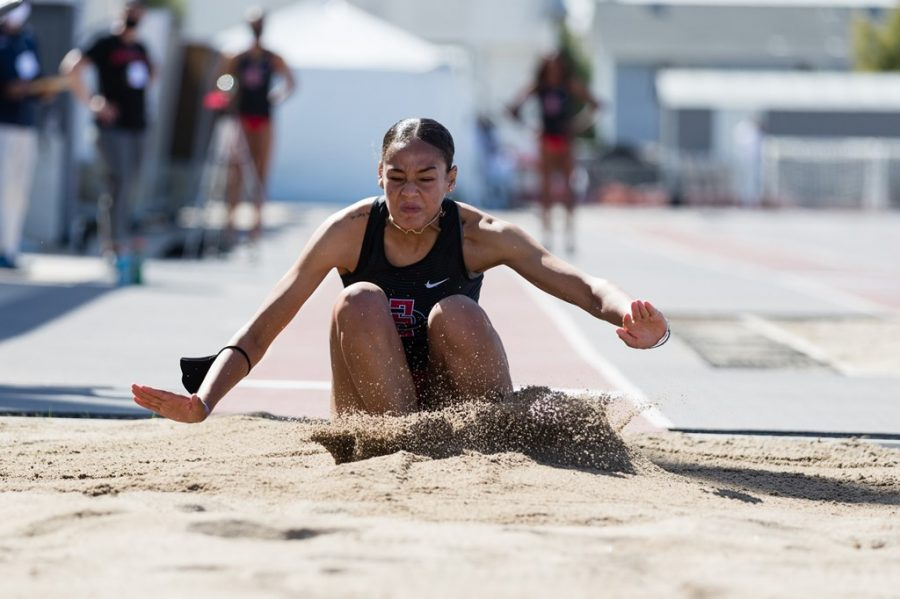 San Diego State track and field freshman Simone Johnson jumps during the Aztecs' 109-60 win over Utah in a dual meet on Feb. 25, 2021 at the Aztrack Sports Deck.