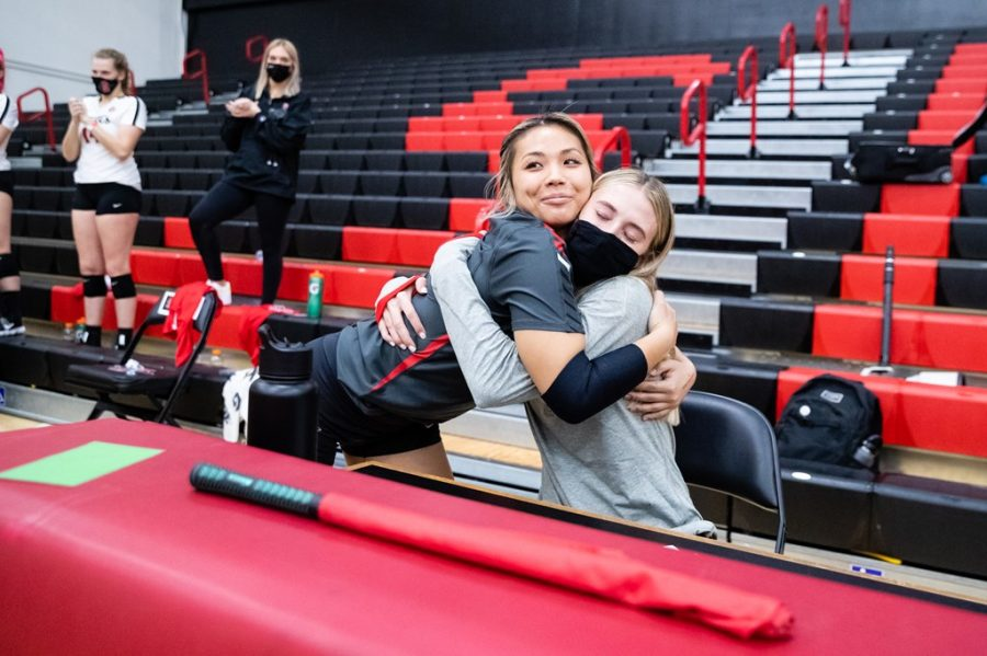 San Diego State volleyball senior libero Lauren Lee (left) hugs senior Camryn Machado during Senior Day festivities before the Aztecs' 3-0 win over Colorado State on April 3, 2021 at Peterson Gym.