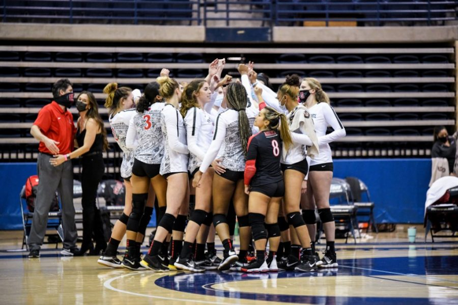The+San+Diego+State+volleyball+team+breaks+it+down+after+defeating+Utah+State+3-2+at+the+Jenny+Craig+Pavilion+on+the+campus+of+the+University+of+San+Diego+on+March+12%2C+2021.