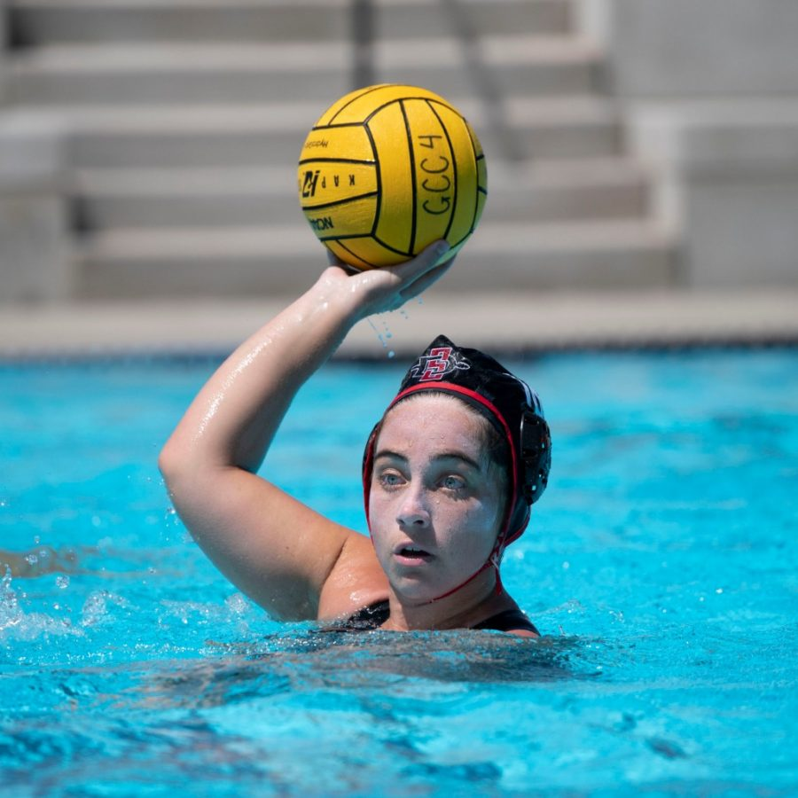 San Diego State water polo senior attacker Rory Nuuhiwa passes the ball during the Aztecs' 11-8 win over the University of Pacific on April 23, 2021 at the Chris Kjeldsen Pool in Stockton, Calif.