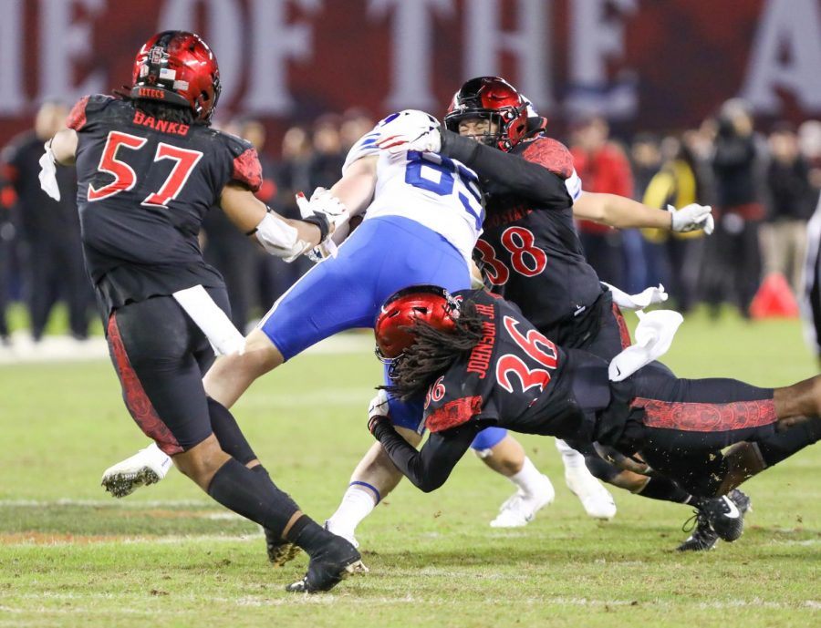 San Diego State football-junior safety Dwayne Johnson Jr. (#36) helps lay a hit on a Brigham Young receiver during the Aztecs' 13-3 victory on Nov. 30, 2019 at SDCCU Stadium.