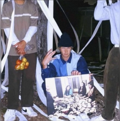 The thieves pose in a photo showing the items they stole from the Chabad House.
