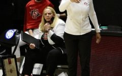 San Diego State women's basketball head coach Stacie Terry-Hutson (right) and assistant coach Marsha Frese look on during a game in the 2020-21 season at Viejas Arena.