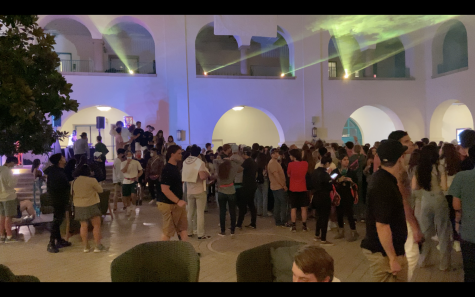 Students gathered to dance under a light show in the Conrad Prebys Aztec Student Union