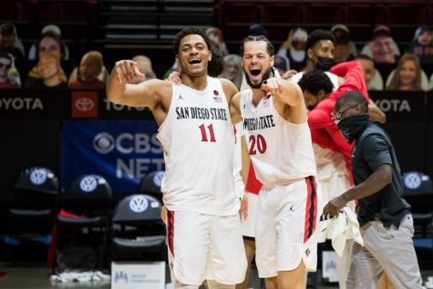Matt Mitchell (left) and Jordan Schakel (right) celebrate after a 62-58 win over Boise State.
