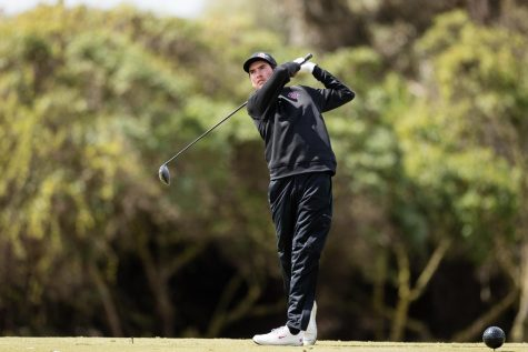 Senior Youssef Guezzale watches the ball after driving it from the fairway. (Courtesy of Derrick Tulsan/SDSU Athletics)