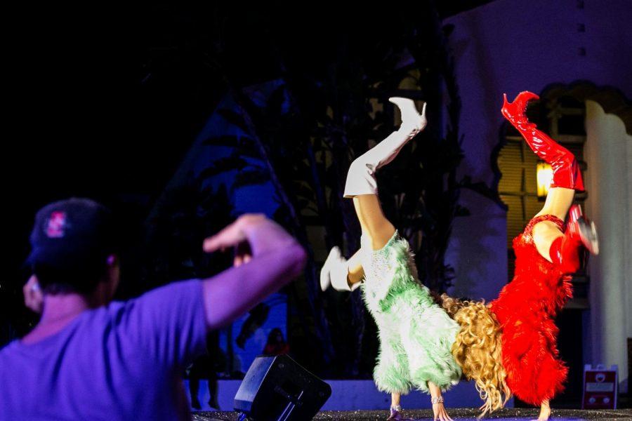 Twin Latina Drag Princesses Isabella and Catalina sync their cartwheels perfectly.