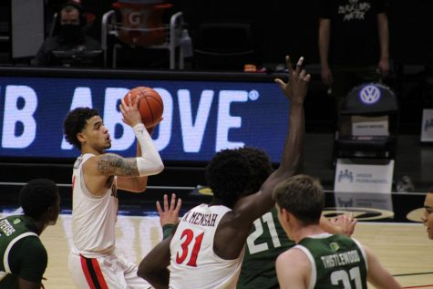 Trey Pulliam (left) goes up for a shot against Colorado State.