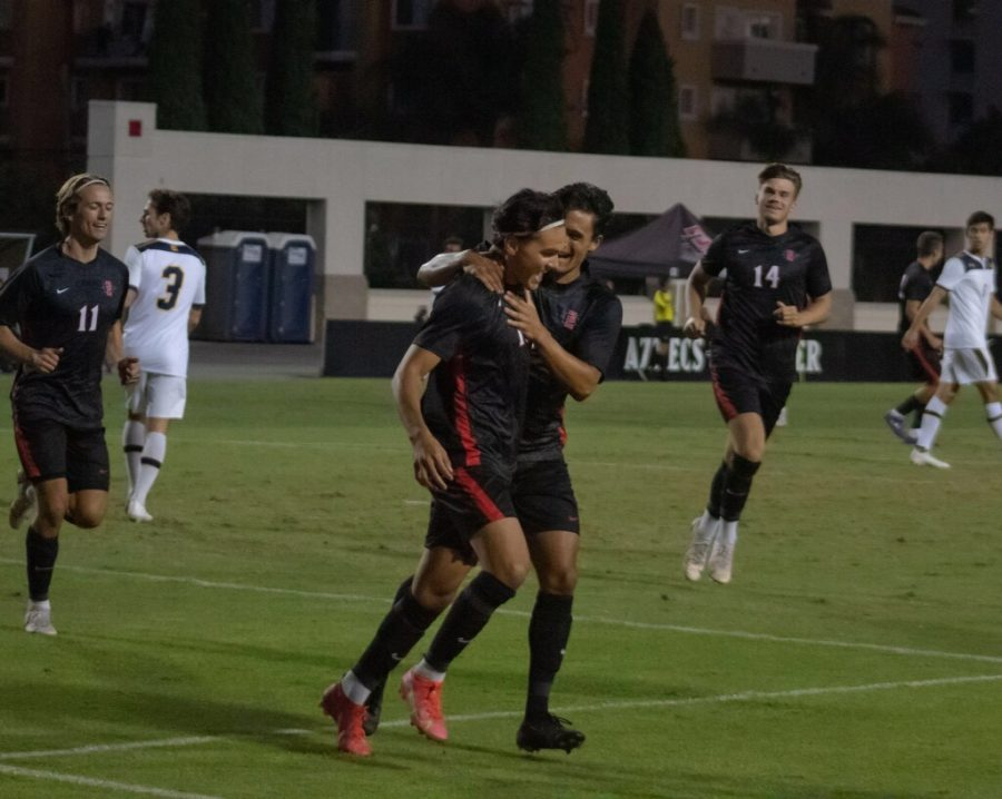 The+Aztecs+celebrate+after+scoring+a+goal+against+Cal.