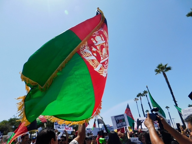 Protesters+march+in+the+streets+of+downtown+to+show+solidarity+with+Afghanistan.