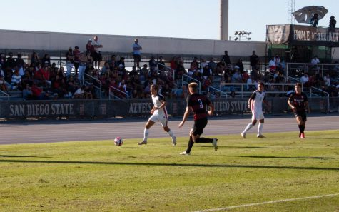 Freshman Alex Hjælmof (left) dribbles towards a Cardinal defender during Sundays match against Stanford.