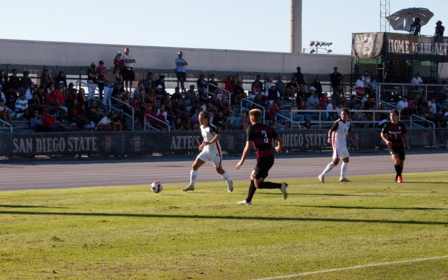 Freshman+Alex+Hj%C3%A6lmof+%28left%29+dribbles+towards+a+Cardinal+defender+during+Sundays+match+against+Stanford.