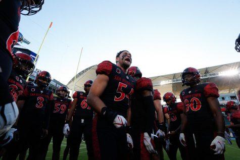Senior captain Caden McDonald (center) hypes the Aztecs up during the game against New Mexico.