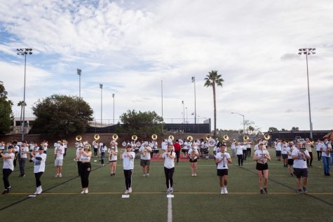 SDSUs marching band practicing the Fight Song on field PG620.