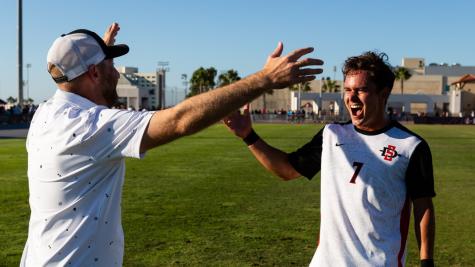 Laukoa Santos celebrating a goal with head coach Ryan Hopkins against Stanford (Courtesy of SDSU Athletics).