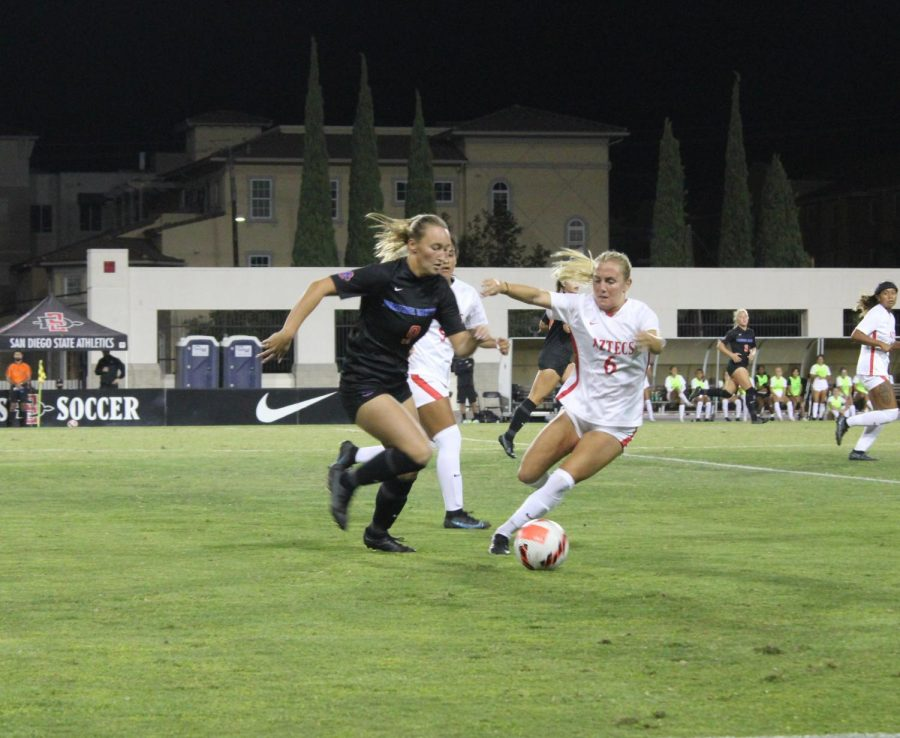 Senior defender Malia Kaleiohi (6) chases down Boise State sophomore Mia Burns (9).