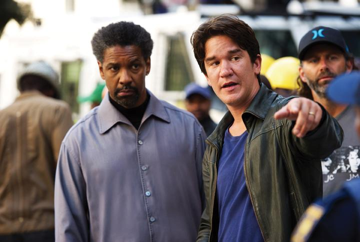 Denzel Washington takes direction from Daniel Espinosa regarding his role as on-the-run ex-CIA agent Tobin Frost. MCT Campus