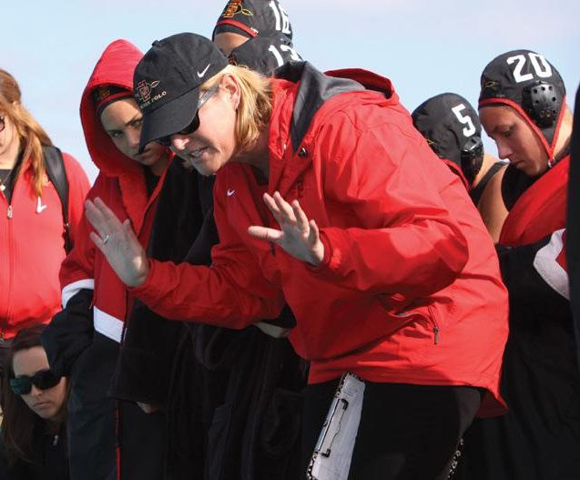 Head coach Carin Crawford speaks to her team in a game during the 2011 season.