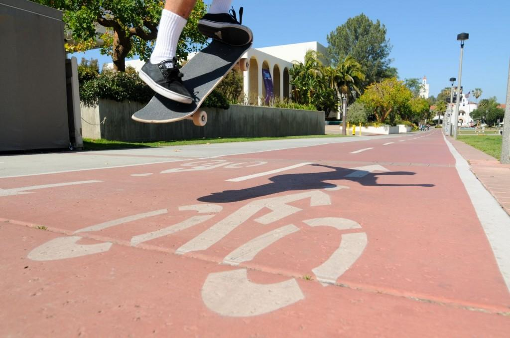 Skateboarder illegally using the Campanile bike lane. | Dustin Michelson, Staff Photographer
