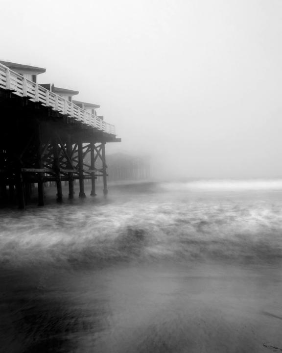 Staff Photographer Antonio Zaragoza took this photo of Pacific Beach's Crystal Pier on an overcast, cold day. According to local lore, the Flying Dutchman only appears in San Diego on days like this, and may even be seen here in the gray distance. Copyright  Antonio Zaragoza